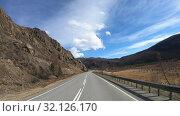 Купить «Driving along mountain road Chuysky Tract along Kurai Ridge on Altai at Spring season», видеоролик № 32126170, снято 3 июля 2019 г. (c) Serg Zastavkin / Фотобанк Лори