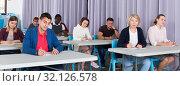 Купить «Adult students listening in classroom», фото № 32126578, снято 8 мая 2018 г. (c) Яков Филимонов / Фотобанк Лори