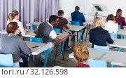 Купить «Rear view of people in auditorium», фото № 32126598, снято 8 мая 2018 г. (c) Яков Филимонов / Фотобанк Лори