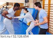 Купить «People fighting with coach at gym», фото № 32126654, снято 31 октября 2018 г. (c) Яков Филимонов / Фотобанк Лори