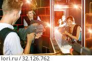 Купить «Laser tag players guys and girls playing in teams in dark laser», фото № 32126762, снято 27 августа 2018 г. (c) Яков Филимонов / Фотобанк Лори