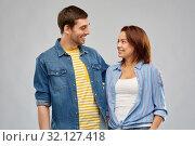 Купить «happy couple hugging and looking at each other», фото № 32127418, снято 17 марта 2019 г. (c) Syda Productions / Фотобанк Лори