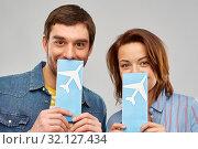 Купить «happy couple with air tickets», фото № 32127434, снято 17 марта 2019 г. (c) Syda Productions / Фотобанк Лори