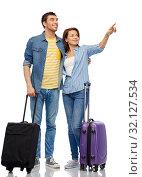 Купить «happy couple of tourists with travel bags», фото № 32127534, снято 17 марта 2019 г. (c) Syda Productions / Фотобанк Лори