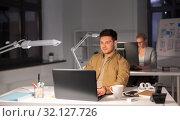 Купить «man with computer working late at night office», фото № 32127726, снято 26 ноября 2017 г. (c) Syda Productions / Фотобанк Лори