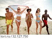 Купить «happy friends with american flag on summer beach», фото № 32127750, снято 29 июля 2018 г. (c) Syda Productions / Фотобанк Лори