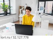 Купить «creative woman working on user interface at office», фото № 32127778, снято 23 февраля 2019 г. (c) Syda Productions / Фотобанк Лори