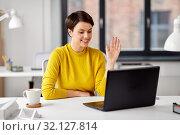 Купить «businesswoman having video call at office», фото № 32127814, снято 23 февраля 2019 г. (c) Syda Productions / Фотобанк Лори