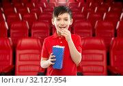 Купить «smiling boy eating popcorn at movie theater», фото № 32127954, снято 9 марта 2019 г. (c) Syda Productions / Фотобанк Лори