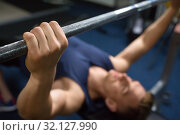 Купить «close up of man with barbell exercising in gym», фото № 32127990, снято 2 июля 2017 г. (c) Syda Productions / Фотобанк Лори