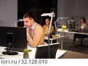 Купить «man with computer working late at night office», фото № 32128010, снято 26 ноября 2017 г. (c) Syda Productions / Фотобанк Лори