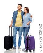 Купить «happy couple of tourists with travel bags», фото № 32128062, снято 17 марта 2019 г. (c) Syda Productions / Фотобанк Лори