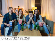 Купить «friends with beer and popcorn watching tv at home», фото № 32128258, снято 22 декабря 2018 г. (c) Syda Productions / Фотобанк Лори