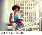 Купить «african student girl reading book at library», фото № 32128318, снято 19 июня 2016 г. (c) Syda Productions / Фотобанк Лори