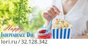 Купить «woman eating popcorn with drink in glass mason jar», фото № 32128342, снято 28 мая 2015 г. (c) Syda Productions / Фотобанк Лори