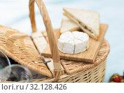 Купить «brie cheese and sandwiches on wicker picnic basket», фото № 32128426, снято 9 августа 2017 г. (c) Syda Productions / Фотобанк Лори