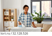Купить «african american woman ironing bed linen at home», фото № 32128526, снято 7 апреля 2019 г. (c) Syda Productions / Фотобанк Лори