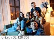 Купить «friends taking picture by selfie stick at home», фото № 32128766, снято 22 декабря 2018 г. (c) Syda Productions / Фотобанк Лори