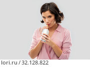 Купить «woman drinking soda from can with paper straw», фото № 32128822, снято 6 марта 2019 г. (c) Syda Productions / Фотобанк Лори