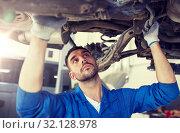 Купить «mechanic man or smith repairing car at workshop», фото № 32128978, снято 1 июля 2016 г. (c) Syda Productions / Фотобанк Лори