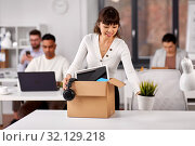 Купить «happy employee with personal stuff at office», фото № 32129218, снято 23 марта 2019 г. (c) Syda Productions / Фотобанк Лори