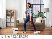 Купить «happy asian woman with mop cleaning floor at home», фото № 32129270, снято 13 апреля 2019 г. (c) Syda Productions / Фотобанк Лори