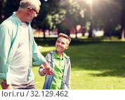 grandfather and grandson walking at summer park. Стоковое фото, фотограф Syda Productions / Фотобанк Лори