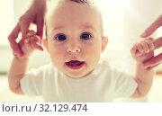 Купить «happy baby learning to walk with mother help», фото № 32129474, снято 12 июля 2016 г. (c) Syda Productions / Фотобанк Лори