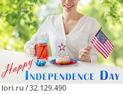 Купить «happy woman celebrating american independence day», фото № 32129490, снято 28 мая 2015 г. (c) Syda Productions / Фотобанк Лори