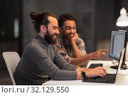 Купить «creative team with computer working late at office», фото № 32129550, снято 24 января 2018 г. (c) Syda Productions / Фотобанк Лори