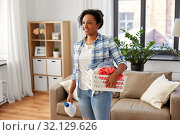 Купить «woman with basket and laundry detergent at home», фото № 32129626, снято 7 апреля 2019 г. (c) Syda Productions / Фотобанк Лори
