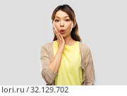Купить «surprised asian woman over grey background», фото № 32129702, снято 11 мая 2019 г. (c) Syda Productions / Фотобанк Лори
