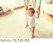 Купить «happy baby learning to walk with mother help», фото № 32129762, снято 12 июля 2016 г. (c) Syda Productions / Фотобанк Лори