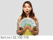 Купить «asian woman with hundred euro money banknotes», фото № 32130118, снято 11 мая 2019 г. (c) Syda Productions / Фотобанк Лори