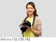 asian female photographer with digital camera. Стоковое фото, фотограф Syda Productions / Фотобанк Лори
