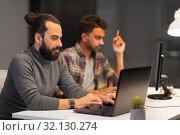 Купить «creative team with computer working late at office», фото № 32130274, снято 24 января 2018 г. (c) Syda Productions / Фотобанк Лори