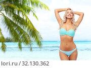 Купить «young woman posing in bikini on beach», фото № 32130362, снято 20 апреля 2017 г. (c) Syda Productions / Фотобанк Лори