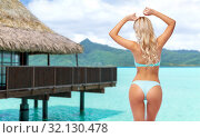 Купить «young woman posing in bikini on beach», фото № 32130478, снято 20 апреля 2017 г. (c) Syda Productions / Фотобанк Лори