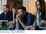 Купить «friends with beer and popcorn watching tv at home», фото № 32130562, снято 22 декабря 2018 г. (c) Syda Productions / Фотобанк Лори