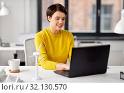 Купить «happy businesswoman with laptop working at office», фото № 32130570, снято 23 февраля 2019 г. (c) Syda Productions / Фотобанк Лори