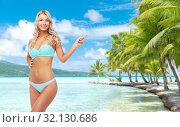 Купить «happy smiling young woman in bikini on beach», фото № 32130686, снято 20 апреля 2017 г. (c) Syda Productions / Фотобанк Лори