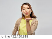 young asian woman sending blow kiss. Стоковое фото, фотограф Syda Productions / Фотобанк Лори
