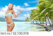 Купить «happy smiling young woman in bikini on beach», фото № 32130918, снято 20 апреля 2017 г. (c) Syda Productions / Фотобанк Лори