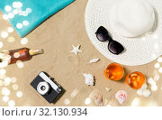 Купить «drinks, hat, camera and sunglasses on beach sand», фото № 32130934, снято 27 июня 2018 г. (c) Syda Productions / Фотобанк Лори