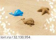 Купить «sand shape made by whale mold on summer beach», фото № 32130954, снято 27 июня 2018 г. (c) Syda Productions / Фотобанк Лори