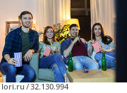 Купить «friends with beer and popcorn watching tv at home», фото № 32130994, снято 22 декабря 2018 г. (c) Syda Productions / Фотобанк Лори
