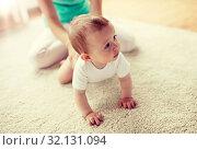 Купить «mother with baby on floor at home», фото № 32131094, снято 12 июля 2016 г. (c) Syda Productions / Фотобанк Лори