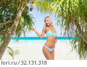 Купить «happy smiling young woman in bikini on beach», фото № 32131318, снято 20 апреля 2017 г. (c) Syda Productions / Фотобанк Лори