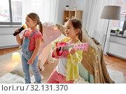 Купить «girls with guitar and microphone playing at home», фото № 32131370, снято 18 февраля 2018 г. (c) Syda Productions / Фотобанк Лори