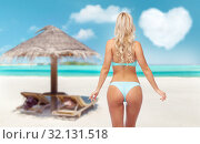 Купить «young woman posing in bikini on beach», фото № 32131518, снято 20 апреля 2017 г. (c) Syda Productions / Фотобанк Лори